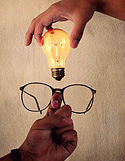 Image of a pair of glasses and a light bulb.
