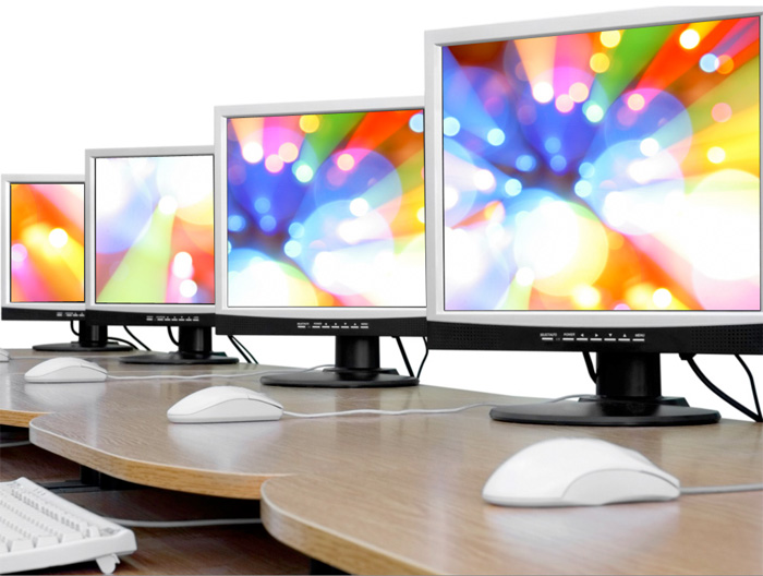 Image of computer monitors on a desk.